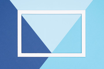 Abstract geometrical flat lay pastel blue colored paper background. Minimalism, geometry and symmetry template with empty picture frame mock up.