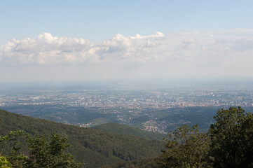 View od Croatia capital Zagreb from Medvednica, Sljeme mountain with green forest, blue sky and white clouds.
