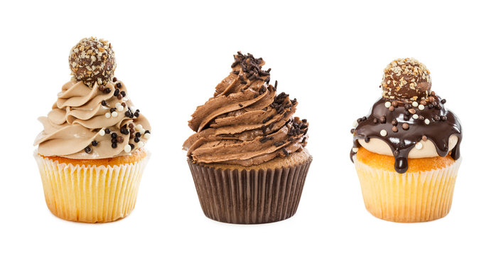 Set of different chocolate cupcakes isolated on white background.