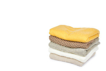 Pile of foldet cloth, isolated on white background. copy space template