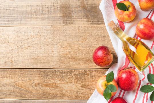Apple cider vinegar in bottle with apple