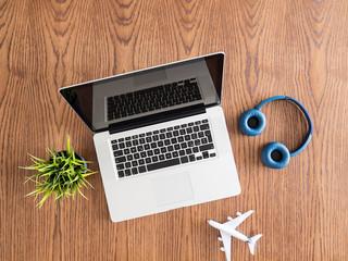 Businessman traveler concept image. Top view flatlay on a wooden desk