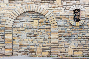 Stone wall of an old house.  Masonry texture_