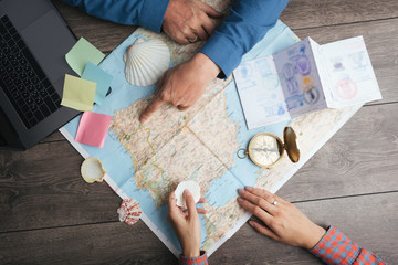 couple are planning Camino de Santiago in Spain. Table with map and compass and hands from above. Top view. preparations for the pilgrims' way Fotomurales