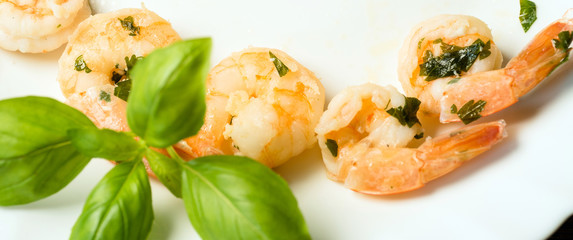 Garlic fried prawns served with croutons of garlic butter