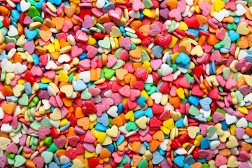 Many heart-shaped candies as background