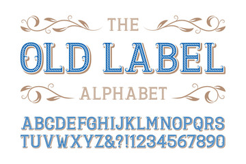 Old label alphabet. Diagonal ribbed letters and numbers with curly serifs.