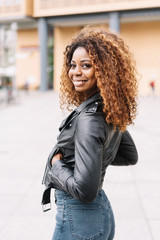 Street portrait of young smiling black woman