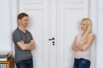 Couple in love waiting in front of a closed door