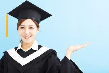 happy graduate student girl showing