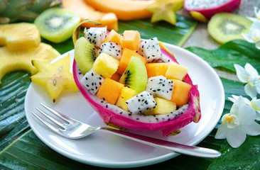 Printed roller blinds Fruits Exotic fruit salad served in half a dragon fruit on palm leaves