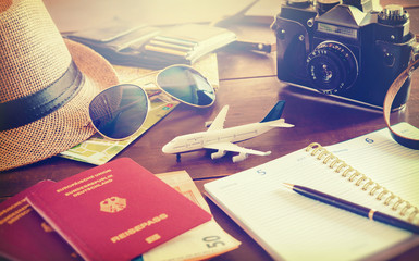 Travel accessories, passports, luggage, the cost of travel maps prepared for the trip on wooden table