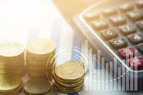 stacked of coins with finance graph and calculator, concept as capital and investment