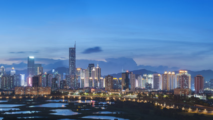 Fototapete - Skyline of Shenzhen City, China at twilight. Viewed from Hong Kong border