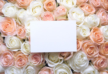 Flat lay stylish mockup photo with a blank greeting card and roses bouquet flowers. Feminine photo for blog and website.