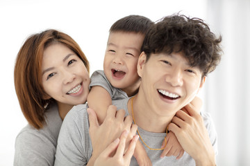 happy family mother, father and child playing