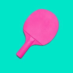 Pink Ping pong paddleson turquoise bakground. Fashion minimal art.