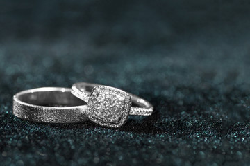 Wedding rings on dark background with copy space.
