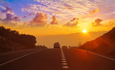 Sunset on the road with golden sky