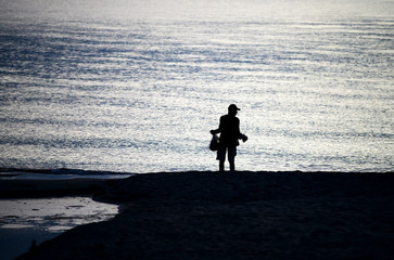 The fisherman stood anticipation by the sea in the morning, at sunrise, Songkhla province, Thailand country