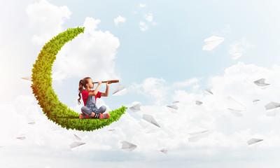 Fototapeta Concept of careless happy childhood with girl on green moon obraz