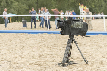 Television camera on the river beach. Camera for taking pictures on the beach.