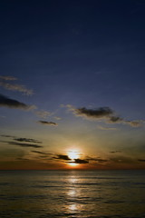 Fantastic sunset over sea. Vertical background for publications on your smartphone