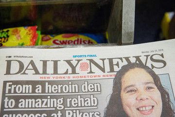 The front page of the New York Daily News is pictured on a newsstand in New York