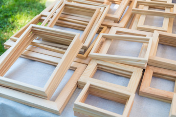 Lot of wooden art frames on street market