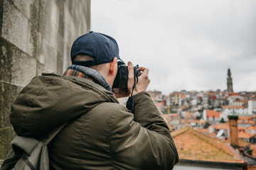 A professional travel photographer or tourist photographs a beautiful urban landscape in Porto in Portugal. Professional occupation or hobby