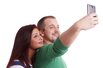happy couple taking a self portrait with smart phone camera