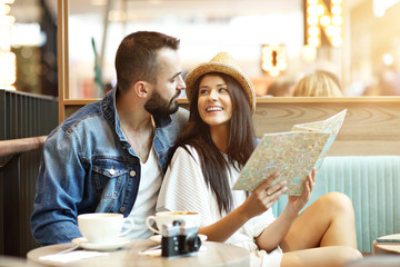 Happy tourists having a break in cafe