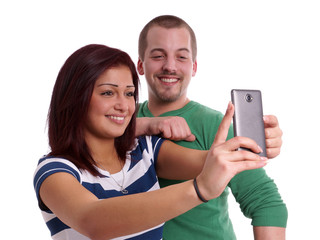 happy couple taking a self portrait with cell phone camera