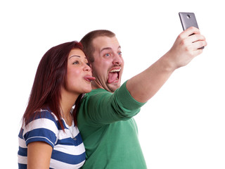 making silly faces while taking a self portrait with smart phone