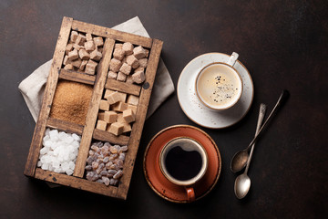 Coffee cups and various sugar