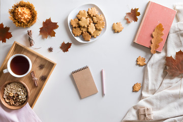 Flat lay, top view of vintage autumn woman office table desk. Workspace with laptop, maple leaves and flowers, diary on white background. Online shopping concept