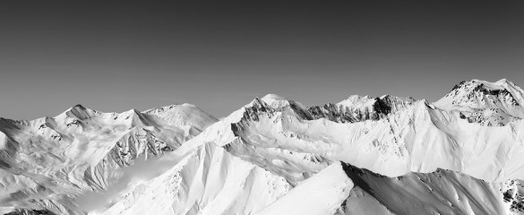 Fototapete - Panorama of snowy winter mountains and clear sky