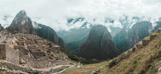 Andes mountains in the early morning mist around Machu Picchu in Peru