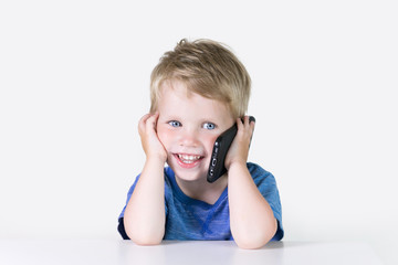 Kids education, developing, technology, mobile phone and internet concept, little child boy using smartphone on white background
