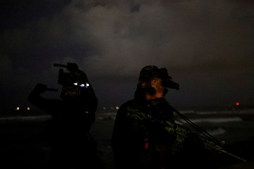 Taiwanese Marine from Underwater Demolition Company, Amphibious Reconnaissance Patrol Unit (ARP), take part in a night-time landing training, in Kaohsiung