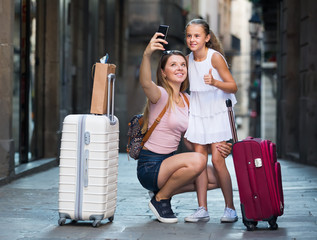 travelers woman and girl photographed on phone