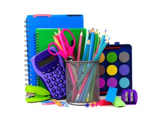 Colorful assortment of school supplies in a cluster isolated on a white background Wall mural