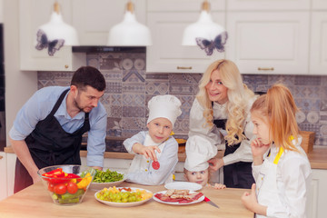 Father, mother and children prepare food together