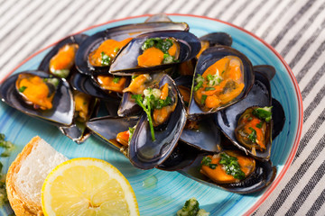 Mussels with herbs on plate