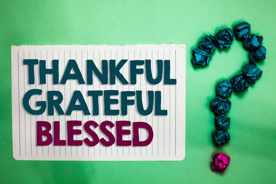Conceptual hand writing showing Thankful Grateful Blessed. Business photo text Appreciation gratitude good mood attitude white notepad with words teal blue lobs form greenery background.