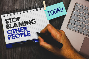 Word writing text Stop Blaming Other People. Business concept for Do not make excuses assume your faults guilt Paperclip grip sticky note with text hand hold pen computer on wooden desk.