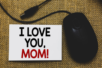 Writing note showing I Love You, Mom. Business photo showcasing Loving message emotional feelings affection warm declaration Traditional mouse alongside white page with written words.