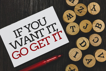 Text sign showing If You Want It, Go Get It.. Conceptual photo Make actions to accomplish your goals wishes Written paper red marker beside round woody alphabets on wooden base.