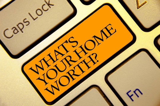 Conceptual hand writing showing What s is Your Home Worth question. Business photo text Value of a house Property Cost Price Rate Golden grey computer keyboard with yellow button black color.