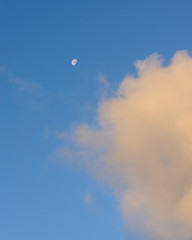 Distant moon wih cloud